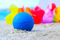 Blue ball on the sand Royalty Free Stock Images