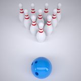 Blue ball and skittles for bowling Royalty Free Stock Photo