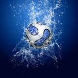 Blue ball in water. Water drops around soccer ball under water on blue background royalty free stock photos