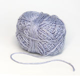 Blue ball of woollen yarn Royalty Free Stock Image