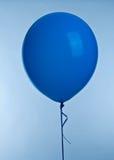 Blue ballon. One blue ballon image on blue background stock photography
