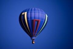 Blue balloon. A blue hot air balloon against a vivid blue sky Stock Images