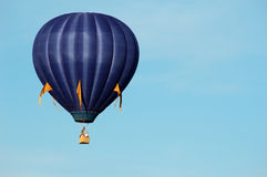 Blue balloon. A hot-air balloon floats over Warren County, Iowa stock image