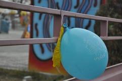 Blue balloon at amusement park stock photography
