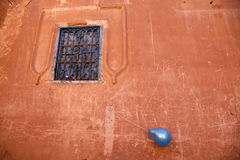 The blue balloon. A blue ballon is is attached to a window in morocco Royalty Free Stock Images