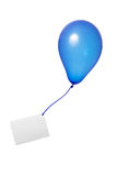 Blue balloon with card. A blue floating balloon with a ribbon and a greeting card isolated on a white background royalty free stock photo