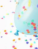 Blue balloon with confetti Stock Images