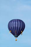 Blue balloon vertical. A hot-air balloon flies over Warren County, Iowa stock images