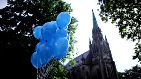 Blue balloons on a background of church stock footage