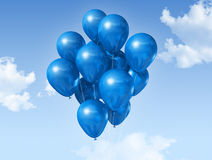 Blue balloons on a blue sky Stock Photography