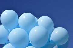 Blue balloons on blue sky background Royalty Free Stock Images