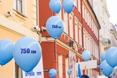 Blue balloons with 750eur sign printed on. Latvian  Teachers participate at picket, protest for pay rise stock photo