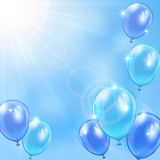 Blue balloons on sky background Stock Photos