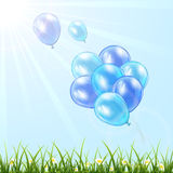 Blue balloons in the sky Royalty Free Stock Photo