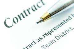 Blue ballpoint pen on a contract. Stock Photos