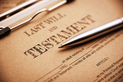 Blue ballpoint pen and a last will and testament on a clip board. royalty free stock photos