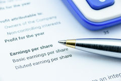 Blue ballpoint pen on an organization's income statement Stock Images