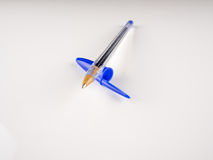 Blue ballpoint pen. On white background Royalty Free Stock Image