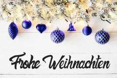 Blue Balls, Calligraphy Frohe Weihnachten Means Merry Christmas. Christmas Banner With German Calligraphy Frohe Weihnachten Means Merry Christmas. Fir tree stock images