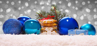 Blue balls and christmas cookies on snow . Royalty Free Stock Photo
