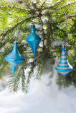 Blue balls on christmas tree outdoors Stock Photo