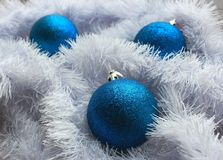 Blue balls and festive white snow decoration as New Year and Merry Christmas decoration. Royalty Free Stock Photography