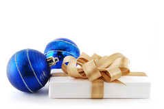 Blue balls and gift Royalty Free Stock Image