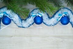 Blue balls with ribbons and Christmas tree branch Stock Image