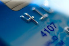 Blue bank card, narrow focus. Macro. Royalty Free Stock Photo