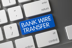 Blue Bank Wire Transfer Keypad on Keyboard. Metallic Keyboard with the words Bank Wire Transfer on Blue Key. Bank Wire Transfer Concept: Metallic Keyboard with stock image