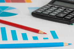 Blue bar charts with calculator and pencils 1 Stock Image