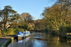Blue barge moored on the Lancaster Canal Stock Photography