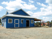 Blue barn in a farm Royalty Free Stock Images