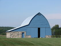 Blue Barn With Stone Foundation Stock Photography