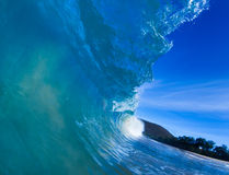 Blue barreling wave. Blue wave breaking into a tube or barrel Stock Photography