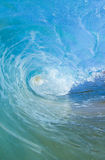 Blue barreling wave. Blue wave breaking into a tube or barrel stock images