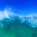 Blue barreling wave. Blue wave breaking into a tube or barrel Royalty Free Stock Photography