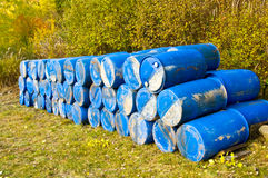 Blue barrels. A lot of blue barrels deposited somewhere outside Royalty Free Stock Photos