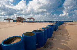 Blue barrels on the beach Stock Photography