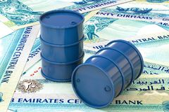 Blue barrels of oil lie on twenty dirhams banknote, United Arab Emirates. Stock Images