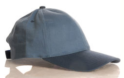 Blue baseball cap Stock Images