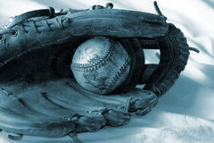 Blue Baseball and glove. Blue duo-toned photo Royalty Free Stock Images
