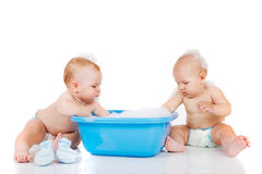 Blue basin and two babies stock image