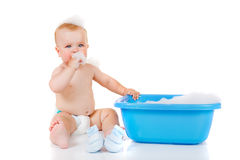Blue basin and two babies stock photography