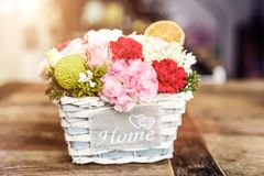 Close-up of beautiful flowers in box with HOME word stock photo
