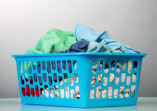 Blue basket with dirty laundry Stock Images