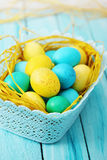 Blue basket of eggs Stock Image