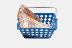 Blue basket with euro bills Royalty Free Stock Images