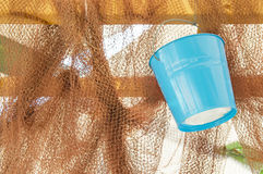 Blue basket on a fishing net Stock Images