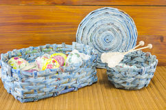 Blue basket full of handcolored Easter Eggs in decoupage Royalty Free Stock Photo